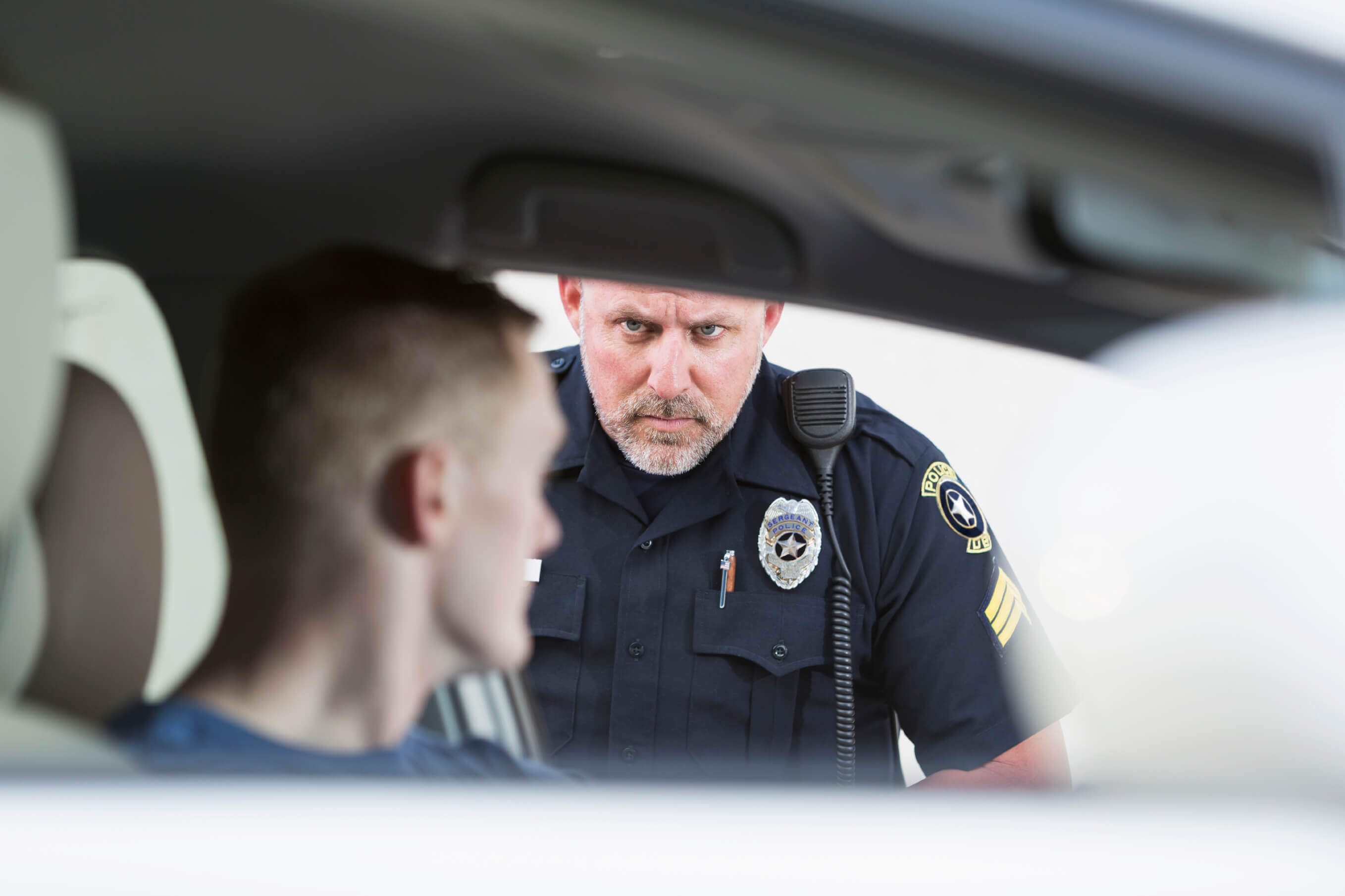 Policeman stopping a driver - checkpoints California